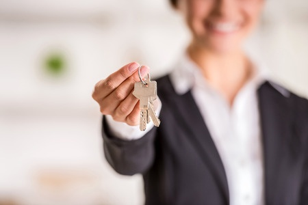 39393958 - realtor is giving the keys to an apartment to clients. focus on the keys.